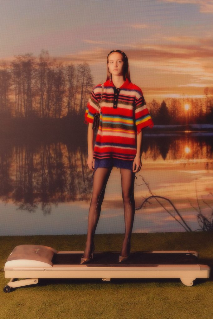 Model In Andersson Bell Multi Striped Knit Polo Sweater Campaign
